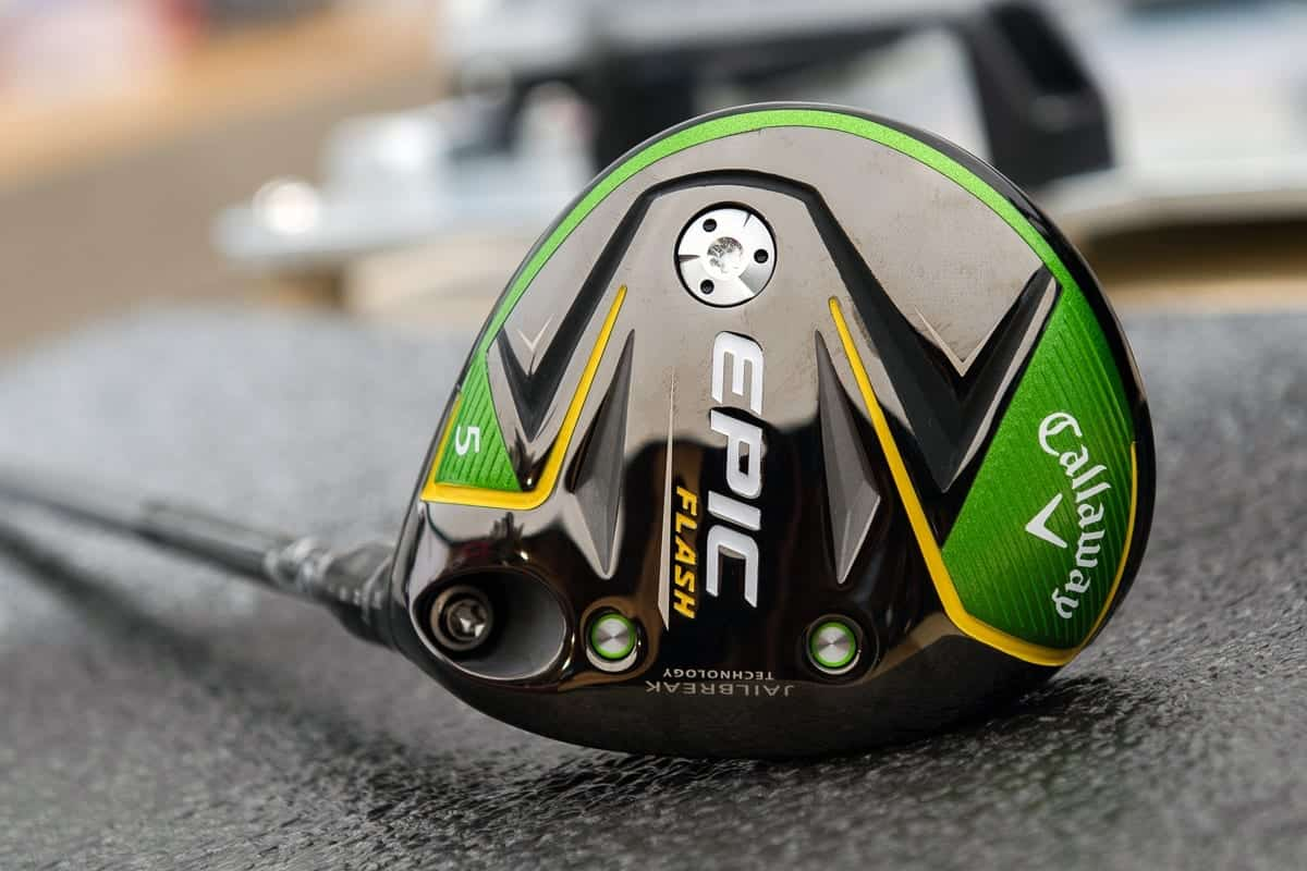 """Callaway Epic Flash Driver laying so the bottom of the driver head facing towards you. Driver head is Black, Green, and accented with Yellow. """"Epic"""" written large in White."""