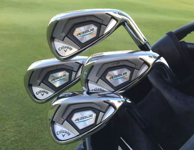 4 callaway rogue irons in a back with a fairway in background with medallion sfacing camera wiht callaway logo.