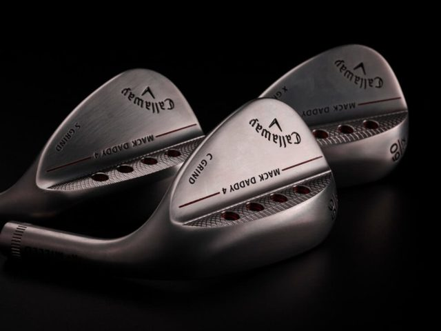 3 Callaway Mack Daddy 4 Raw wedges laying down so the club face is facing away from the camera.