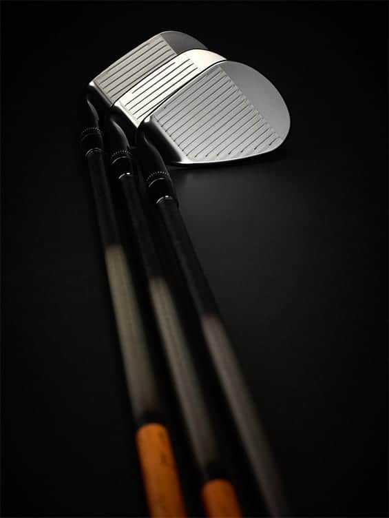 Callaway Mack Daddy Limited picture of the grooves. 3 Golf clubs laying on top of one another.