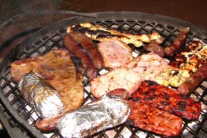 South African braai, also known as Barbeqcue. Sausage, Steaks, Pork Chops.