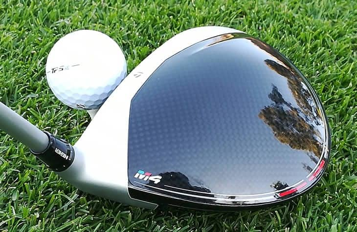 TaylorMade M4 D-Type Driver lined up behind a teed up golf ball.