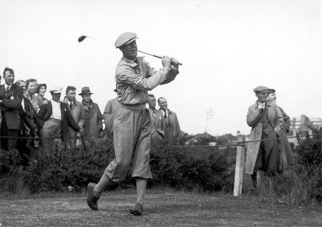 Golf Legend Byron Nelson Eyes up hit tee shot after making contact while the crowd watches with excitement. Circa 1945.