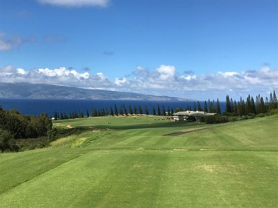 A view from the tee box at the Par 5 663 yard 18th hole a Kapalua Plantation Course in Maui, Hawaii.