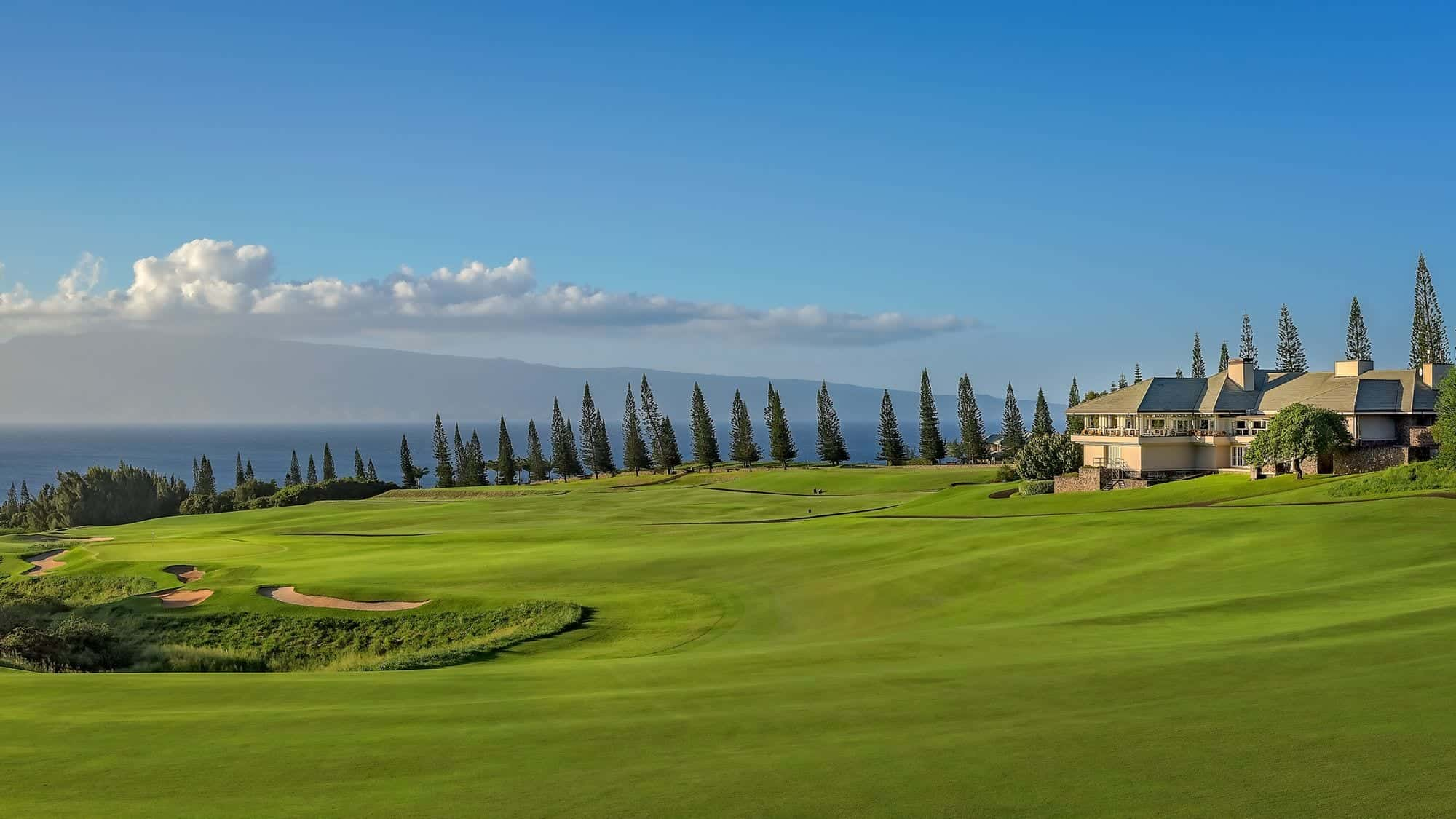 A view of a fairway and the clubhouse at Kapalua Plantation Course in Maui, Hawaii.