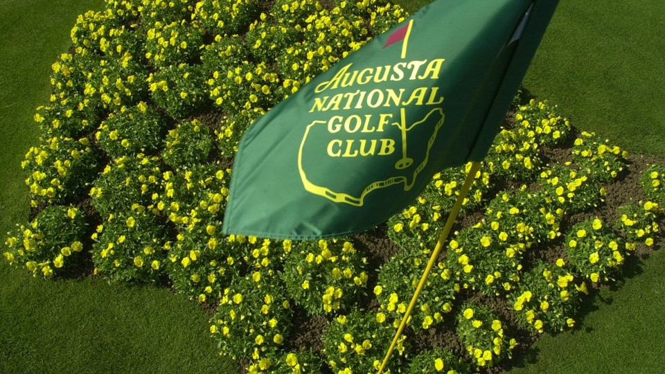 This April 7, 2002 file photo shows The Augusta National Golf Club flag framed by yellow flowers planted in the shape of the United States on display in front of the clubhouse in Augusta, Ga. For the first time in it's 80-year history, Augusta National Golf Club has female members. The home of the Masters, under increasing criticism the last decade because of its all-male membership, invited former Secretary of State Condoleeza Rice and South Carolina financier Darla Moore to become the first women in green jackets when the club opens for a new season in October.