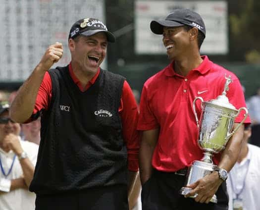 Tiger Woods holding the trophy after winning the 18-hole playoff at the 2008 U.S. Open laghing with Rocco Mediate whom he had just beat in the one-on-one playoff