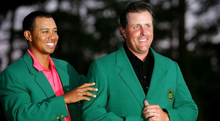 Tiger Woods Presents Phil Mickelson with the Green Jacket after winning it the prior year.