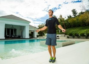 Dustin Johnson jumping rope by a pool for his workout. Dustin Johnson Workout