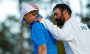 Jordan Spieth being consoled by his caddie, Michael Greller, after hitting twice consecutive shots into the water on the 12th hole, nicknamed Golden Bell, at the 2016 Masters tournament. Amen Corner