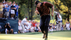 Tiger Woods chasing after his putt during the playoff in the 2000 PGA Championship at Valhalla