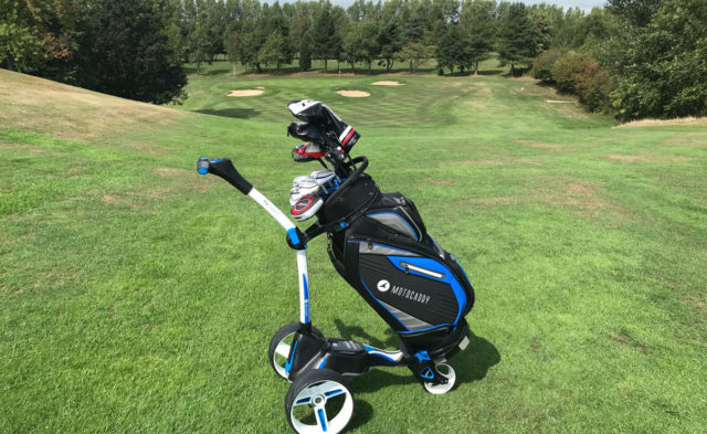 Motocaddy Stand Bag with Trolley on a golf fairway