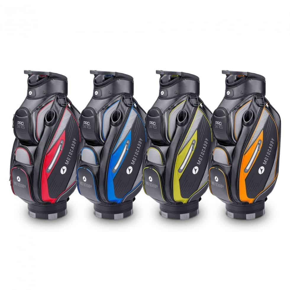 4 Motocaddy Pro Series bags. from the left a red bag, blue, yellow, and orange.
