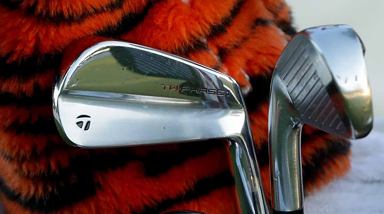 TaylorMade TW Phase Prototype Irons sitting atop Tiger Woods' famous Tiger Driver Cover