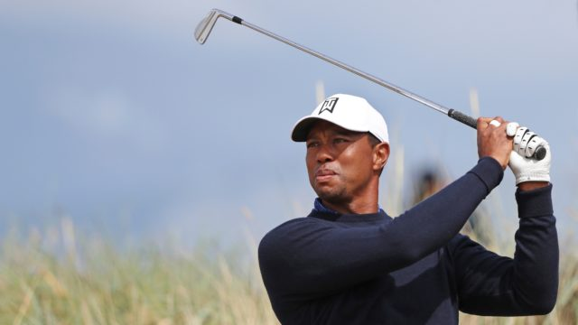 Tiger Woods of the U.S. tees off on the 6th hole during a practice round for the 147th British Open Golf championships in Carnoustie, Scotland 2018