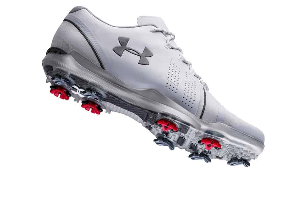 Under Armour Spieth 3 Golf Shoes with white background so you can see the red and black spikes on the sole of the shoe. One shoe pictured in White.