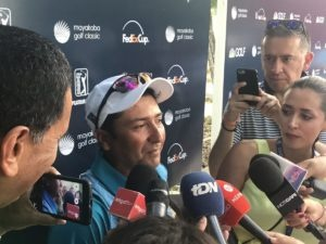 David Ortiz, Matt Kuchar's fill-in caddie for the Mayakoba Golf Classic, answers question at a media scrum after the victory