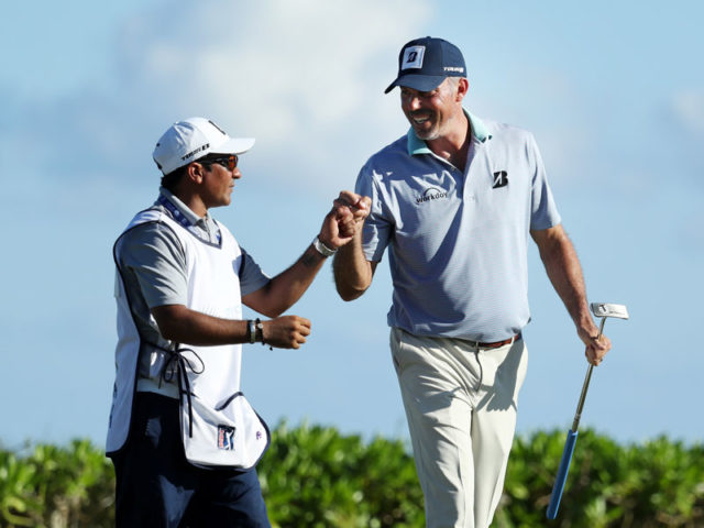 Matt Kuchar fist bumping his fill-in caddie Tucan at the Mayakoba Golf Classic