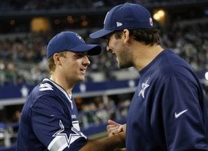 Jordan Spieth shaking hands with Dallas Cowboys quarterback Tony Romo