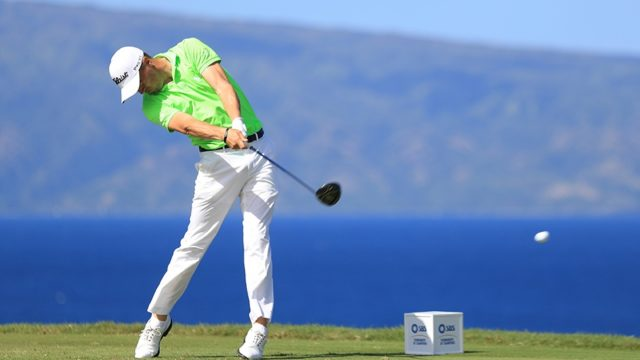 Justin Thomas of the United States plays his shot from the 13th tee during the final round of the SBS Tournament of Champions at the Plantation Course at Kapalua Golf Club on January 8, 2017 in Lahaina, Hawaii
