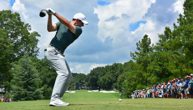 A view from behined Rory McIlroy as he begins his downswing on his tee shot