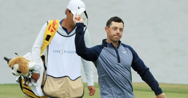 Rory McIlroy salutes the crowd with his hat off on the 18th green at TPC Sawgrass as he walks off the course after winning The Players Championship in 2019 at TPC Sawgrass