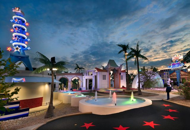 Palm trees and fountains line the entry way to Shoot for the Stars mini golf course