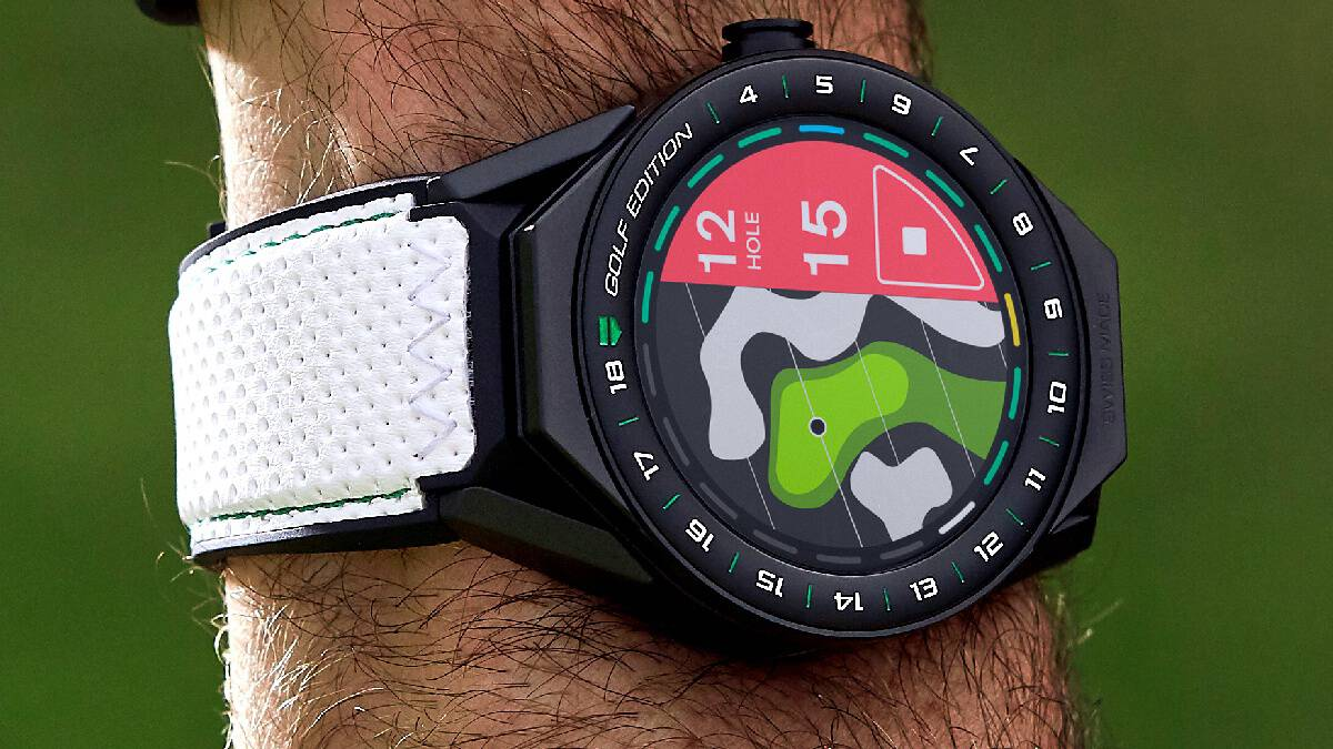 Close up of the TAG Heuer Connected Modular 45 Golf Edition Watch on a mans wrist displaying a golf hole with various yardage markers.
