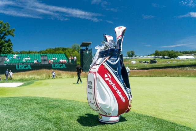Dustin Johnson's Golf Bag with TaylorMade logo in red, white, and blue