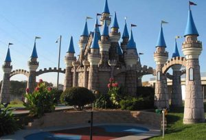 Giant castle behind a series of bridges at the Camelot Golfland in Anaheim, CA