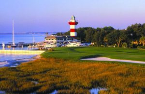 18th hole fairway at Harbour Town Golf Links in Hilton Head Island, SC with golden brown rough lining the fairway and the red and white striped lighthouse in the backdrop