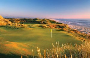 The green on hole 11 at Pacific Dunes Golf Course overlooking the Pacific Ocean. Best Public Golf Courses in America.