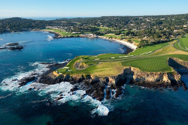 Aerial view of Pebble Beach Golf Links with the waves crashing on the cliffs of California