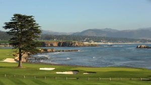 A view of the 18th hole at Pebble Beach with the green overlooking the Pacific Ocean. Pebble Beach takes the number 1 spot in the list of the best public golf courses in amaerica.