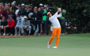 Rickie Fowler swinging an iron at the 2018 Masters Tournament at Augusta National