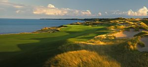 Hole 2 fairway at Whistling Straits - Straits Course with a view of Lake Michigan and golden brown fescue lining the hole. Best Public Golf Courses in America.