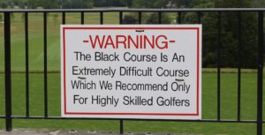 Warning sign at Bethpage Black Golf Course that warns golfers of the difficulty