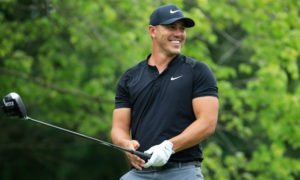 Brooks Koepka of the United States smiles after playing a shot during a practice round prior to the 2018 PGA Championship at Bellerive Country Club