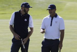 Dustin Johnson talking with Brooks Koepka at the Ryder Cup
