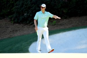 Justin Rose walking on the 12th green at Augusta National Golf Club during the 2017 Masters tournament
