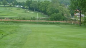 View of the green on hole 1 at Oakmont Country Club outside of Pittsburgh, PA