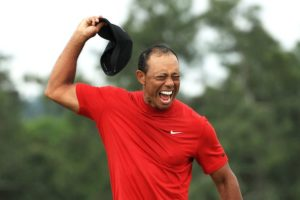 Tiger takes his hat off and yells in celebration after winning the 2019 Masters Tournament played at Augusta National Golf Club
