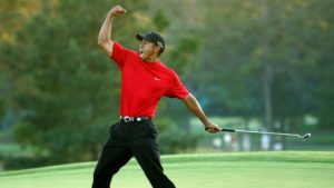 Tiger celebrating with a fist pump at the Masters played at Augusta National Golf Club.