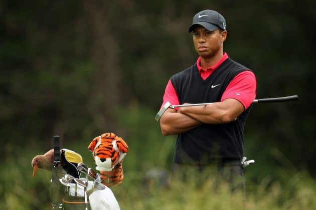 Tiger Woods stands behind his back with his arms crossed wearing his traditional red and black outfit for teh final round of the 2009 US Open at Bethpage Black