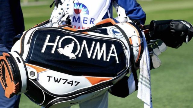 Justin Rose's Golf Bag in black, orange, and white with large