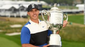 Brooks Koepka hoisting the Wanamaker Trophy after winning the PGA Championship for the second consecutive year
