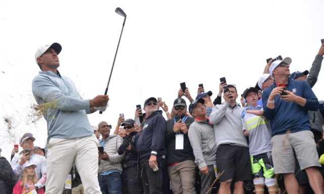 Brooks Koepka hits a shot out of the rough at the 2019 US open. Travelers Championship preview 2019