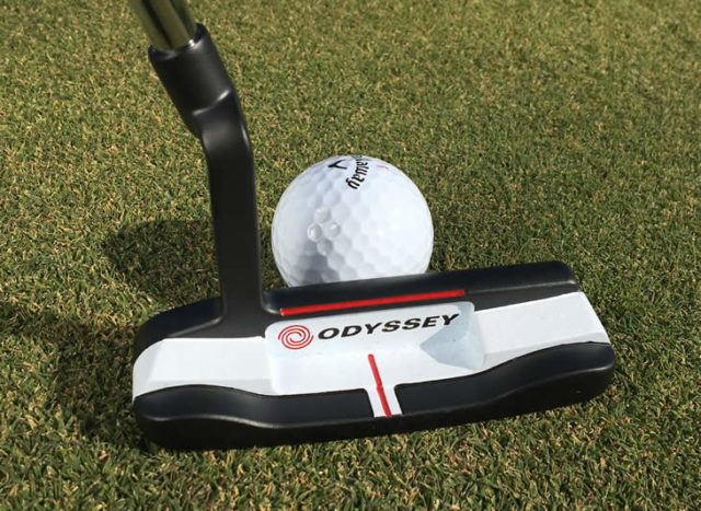 Odyssey O-Works putter in the action of a putting stroke